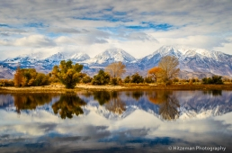 Reflections of teh Eastern Sierra mountains in a pond in Owens Valley,near Bishop, California