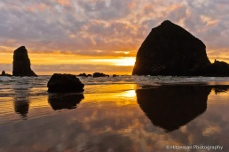 Sunset reflections of the Haystack Rock and The Needles, Cannon Beach, Oregon